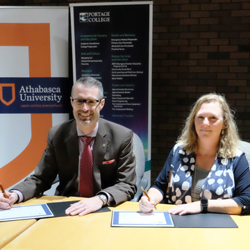 Athabasca University President Dr. Neil Fassina and Portage College President Nancy Broadbent signed a Memorandum of Action Oct. 16 to strengthen the partnership between the two institutions.
